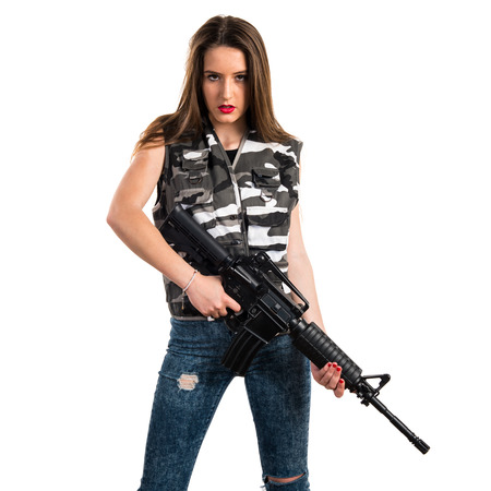 Young girl holding a rifle