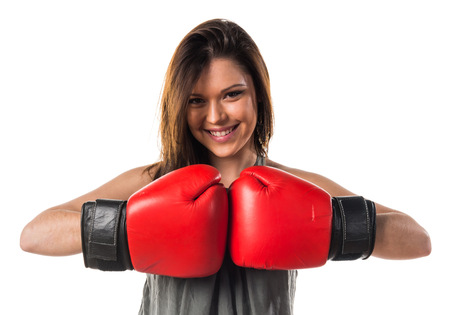 girl punch: Young girl with boxing gloves Stock Photo