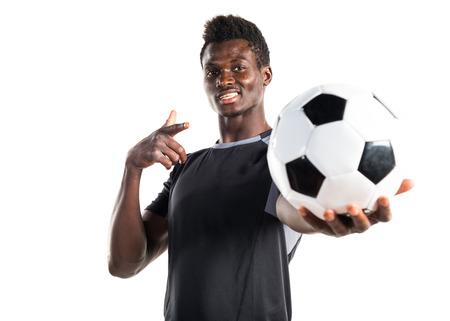 Black man playing football Stock Photo
