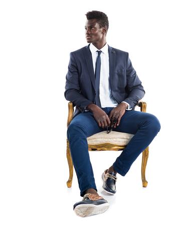 persona sentada: hombre negro de negocios hermoso