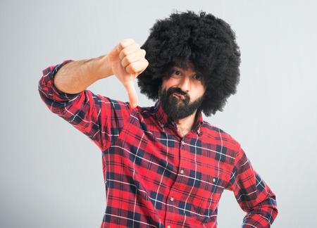 afro man: Afro man doing bad signal