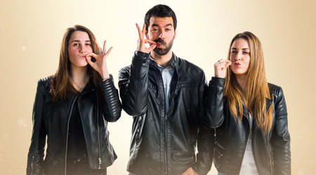 silence gesture: Friends making silence gesture Stock Photo