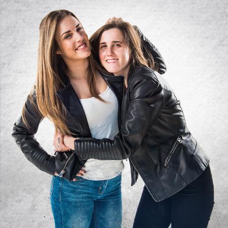 blonde hispanic: Friends with black leather jacket