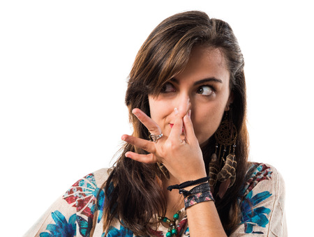 white girl: Young girl making smelling bad gesture Stock Photo