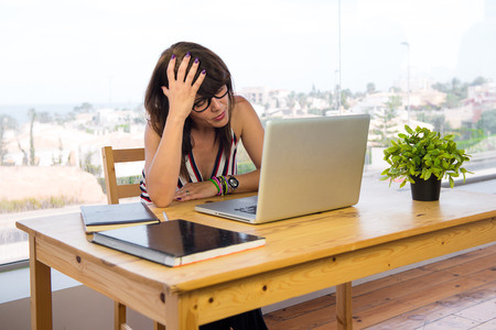 laptot: Frustrated business woman working with a laptot