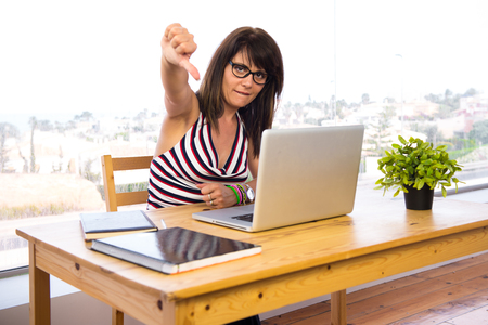 laptot: Business woman working with his laptot doing bad signal Stock Photo