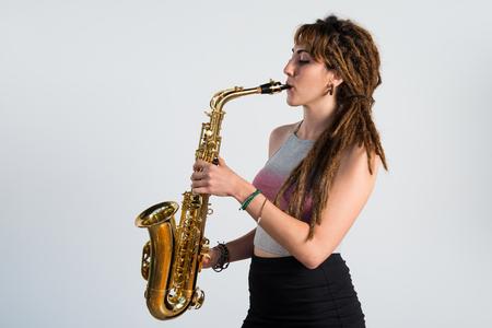 dreadlocks: Girl with dreadlocks playing the saxophone Stock Photo
