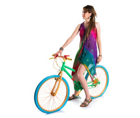 rastas: Chica con rastas en bicicleta colorido