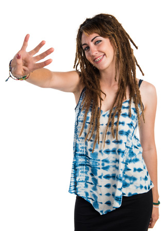 dreadlocks: Girl with dreadlocks counting four Stock Photo