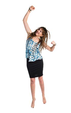 rastas: Chica con rastas haciendo gesto de la victoria Foto de archivo