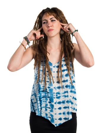 dreadlocks: Girl with dreadlocks covering her ears Stock Photo