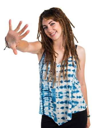counting five: Girl with dreadlocks counting five