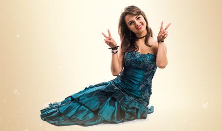 bridesmaid: Bridesmaid doing victory gesture