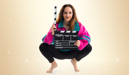 clapperboard: Young woman holding a clapperboard Stock Photo
