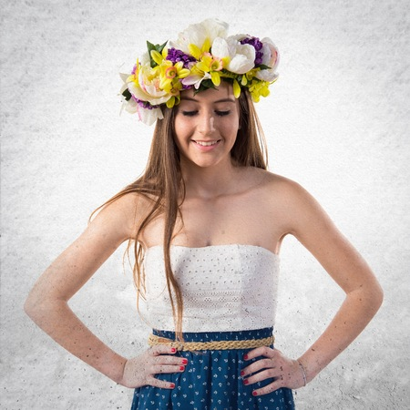 Girl with crown of flowers looking down Stock Photo