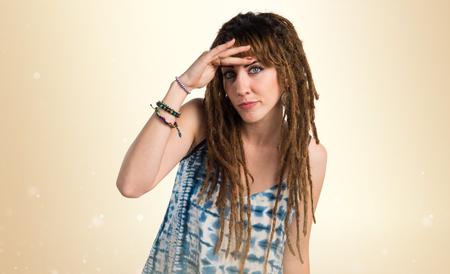 rastas: Girl with dreadlocks showing something