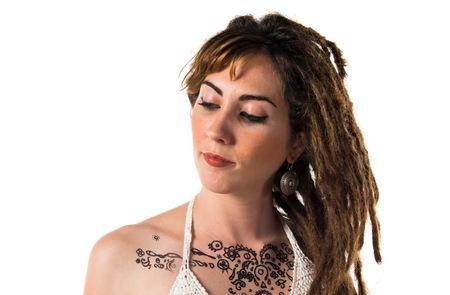dreadlocks: Tattooed girl with dreadlocks posing in studio