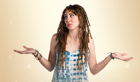 Girl with dreadlocks making unimportant gesture