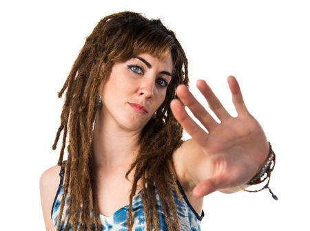 rastas: Girl with dreadlocks making stop sign Foto de archivo
