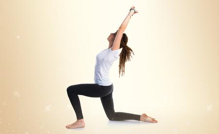 rastas: Young girl with dreadlocks doing yoga