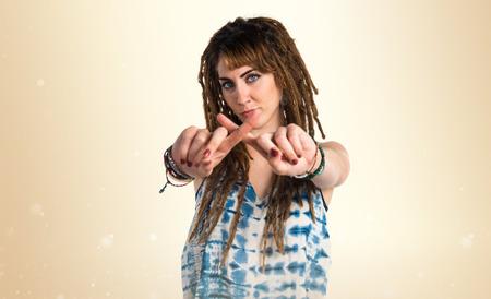 dreadlocks: Girl with dreadlocks doing NO gesture Stock Photo