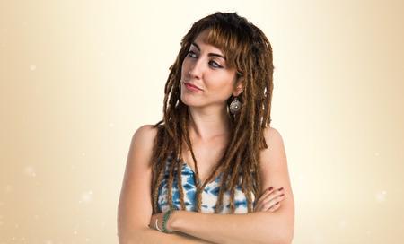 dreadlocks: Girl with dreadlocks thinking