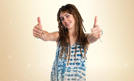 dreadlocks: Girl with dreadlocks with thumb up