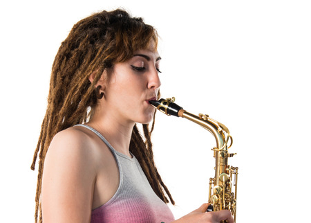 symphonic: Girl with dreadlocks playing the saxophone Stock Photo