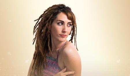 Girl with dreadlocks posing in studio