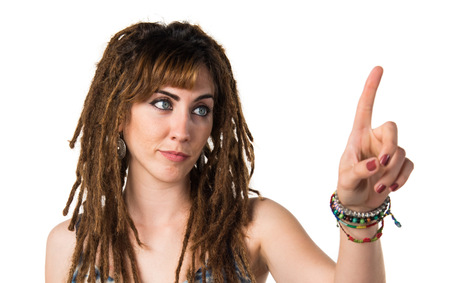 Girl with dreadlocks touching on transparent screen Stock Photo