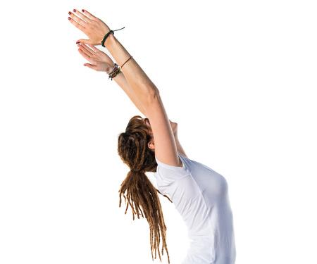 dreadlocks: Young girl with dreadlocks doing yoga