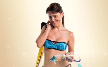 flippers: Chica en bikini con aletas de buceo Foto de archivo