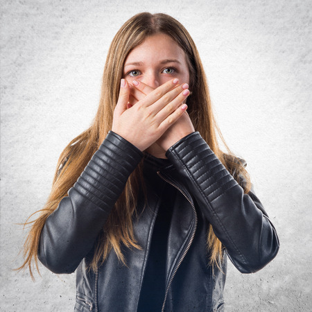 covering: Teen girl covering her mouth
