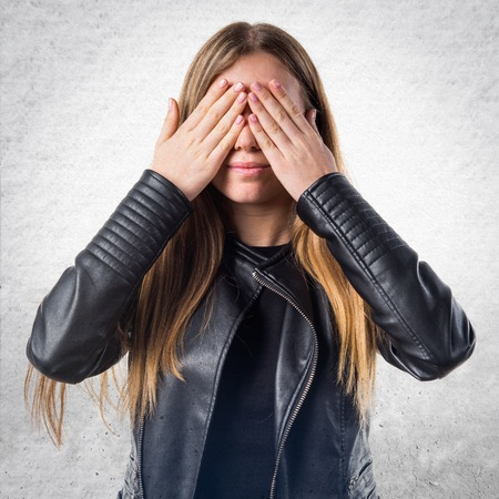 covering: Teen girl covering her eyes Stock Photo