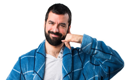 dressing gown: Man in dressing gown making phone gesture
