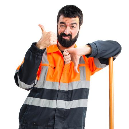 Garbage man making good-bad sign