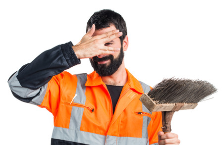 covering: Garbage man covering his face Stock Photo