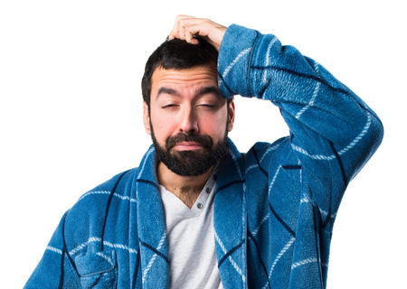 dressing gown: Man in dressing gown thinking