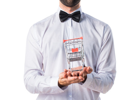 business service: Waiter holding a supermarket cart toy Stock Photo