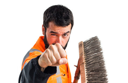 sweeper: Garbage man giving a punch Stock Photo