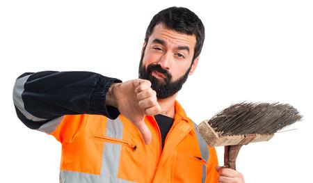 sweeper: Garbage man doing bad signal Stock Photo
