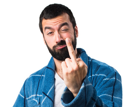 dressing gown: Man in dressing gown making horn gesture