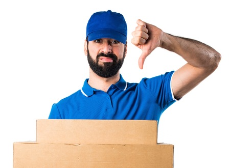 Delivery man doing bad signal Stock Photo
