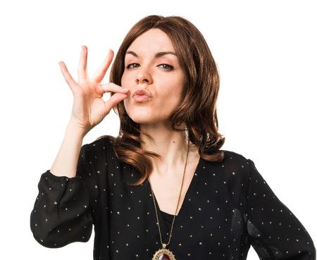 silence gesture: Woman making silence gesture