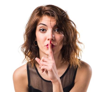 silence gesture: Pretty girl making silence gesture