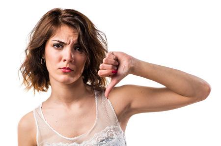 Woman doing bad signal