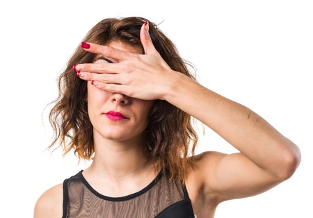 gesticulate: Pretty girl covering her eyes Stock Photo