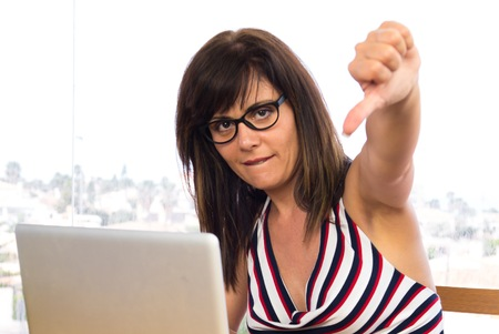 Business woman working with his laptot doing bad signal Stock Photo
