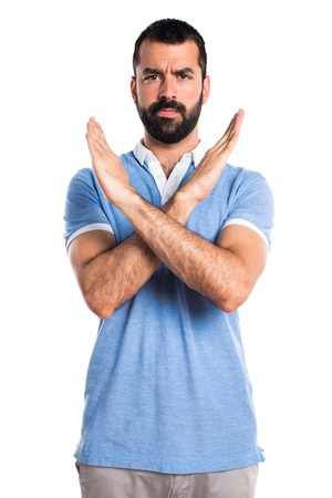 Man with blue shirt doing NO gesture