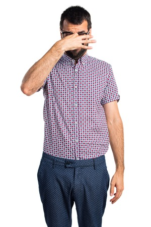 pinching: Man with glasses doing smelling bad gesture Stock Photo